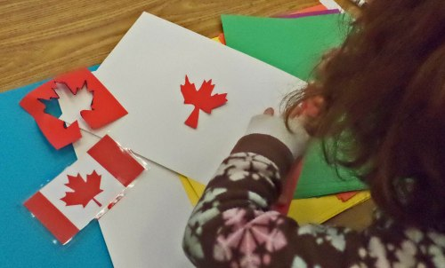 The Canadian flag is very popular with students, who discover how to cut out a silhouette of a maple leaf.