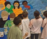 Students took turns painting the mural.