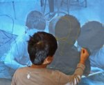 Students traced projected photos.