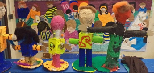 These paper mache sculptural creatures admire the 2nd grade mural.