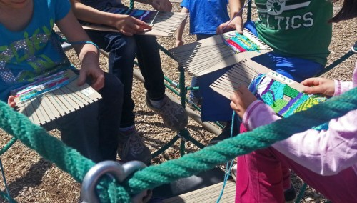 "Children weaving on the ""spider"" playground structure."