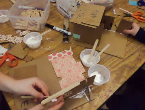 Children practice their design skills by constructing structures at the 3D studio.