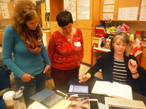 "Kathleen Flynn and Susan Bivona look at Katie McCabe's ""High Five"" assessments."
