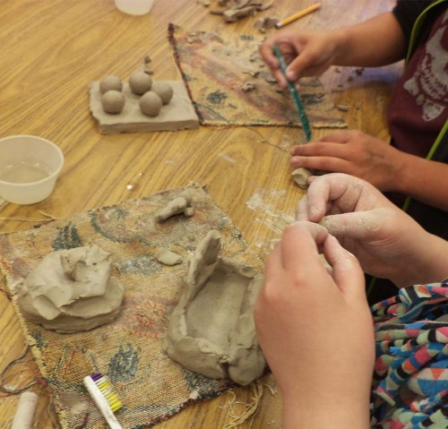 Third graders develop craft with clay techniques.