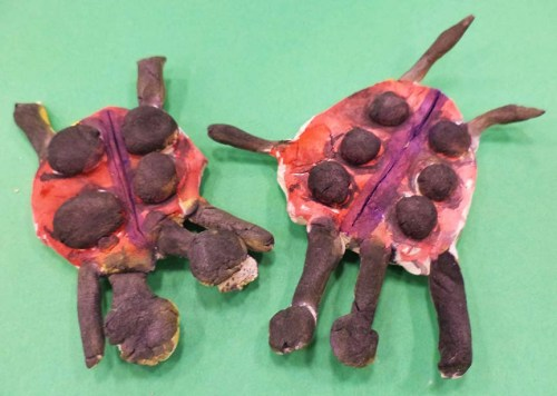 Two ladybugs lovingly created by a first grader.