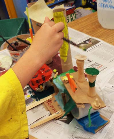 Paint is going away soon so students are eager to paint their 3D structures before taking them home.