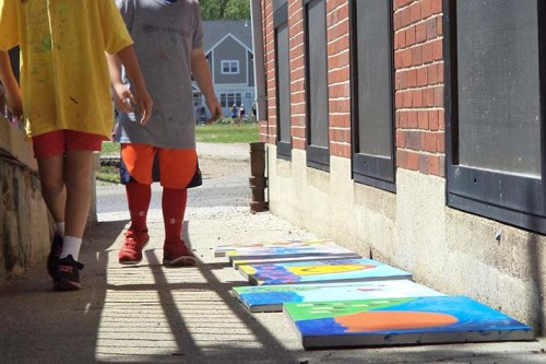 In order to make the best use of our time students placed their paintings outside to dry quickly in the sun so they could add details on top of painted areas.